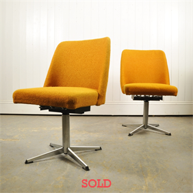 A pair or German Swivel Chairs