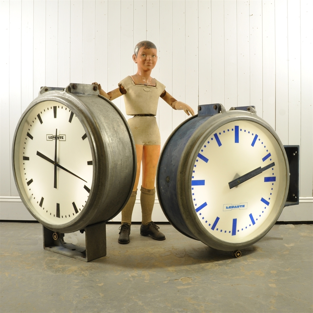 A Large Pair Of Double Sided Station Clocks